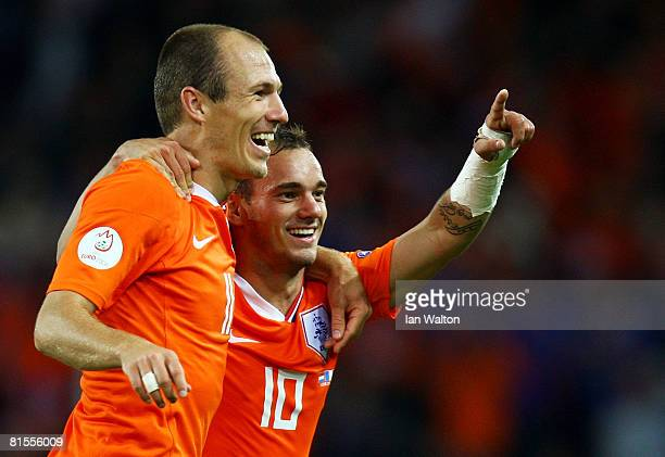 Wesley Sneijder of Netherlands celebrates with Arjen Robben after scoring his teams fourth goal during the UEFA EURO 2008 Group C match between...