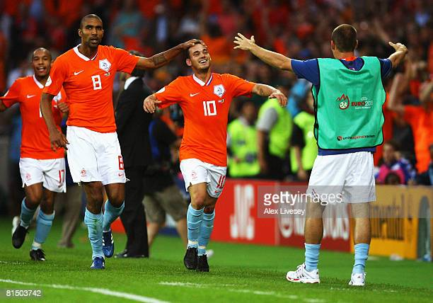 Wesley Sneijder of Netherlands celebrates with team mates after scoring the second goal during the UEFA EURO 2008 Group C match between Netherlands...