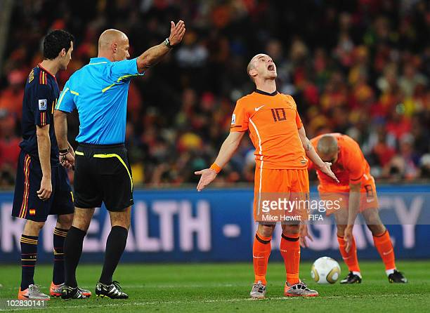 Wesley Sneijder of Netherlands reacts to a decision by referee Howard Webb of Englandduring the 2010 FIFA World Cup South Africa Final match between...