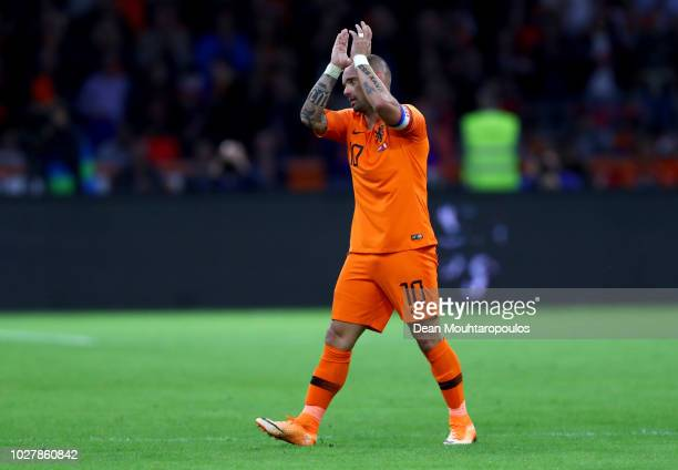 Wesley Sneijder of the Netherlands acknowledges the fans as he walks off after playing his last ever game for The Netherlands during the...
