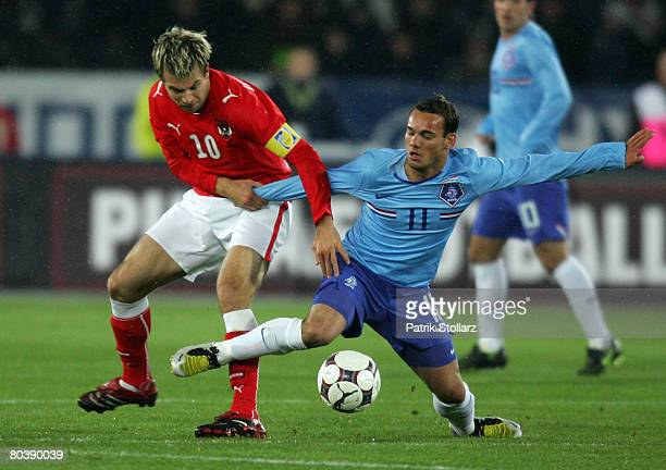 Wesley Sneijder of the Netherlands and Andreas Ivanschitz of Austria fight for the ball during the international friendly match between Austria and...