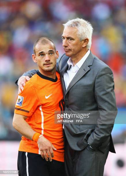 Wesley Sneijder of the Netherlands and head coach Bert van Marwijk celebrate their victory after the 2010 FIFA World Cup South Africa Group E match...