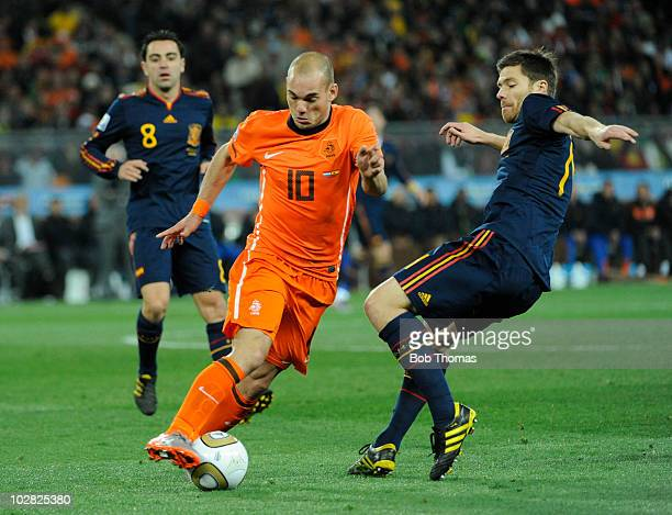 Wesley Sneijder of the Netherlands avoids the tackle of Xabi Alonso of Spainduring the 2010 FIFA World Cup Final between the Netherlands and Spain on...