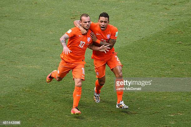 Wesley Sneijder of the Netherlands celebrates scoring his team's first goal with Memphis Depayduring the 2014 FIFA World Cup Brazil Round of 16 match...