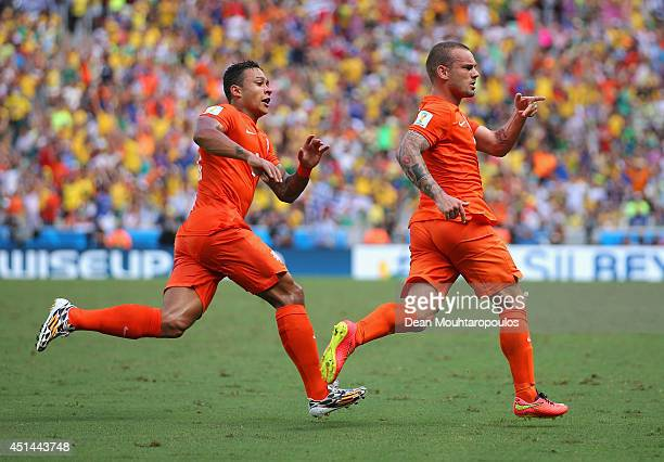 Wesley Sneijder of the Netherlands celebrates scoring his team's first goal with Memphis Depay during the 2014 FIFA World Cup Brazil Round of 16...