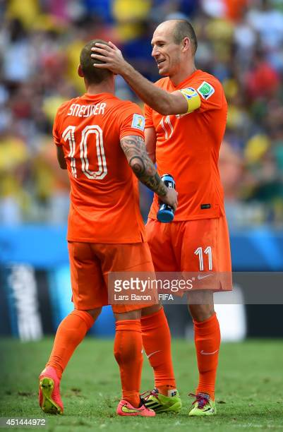 Wesley Sneijder of the Netherlands celebrates scoring his team's first goal with his teammateArjen Robben during the 2014 FIFA World Cup Brazil Round...