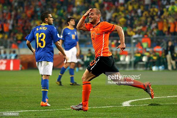 Wesley Sneijder of the Netherlands celebrates scoring his team's second goal during the 2010 FIFA World Cup South Africa Quarter Final match between...