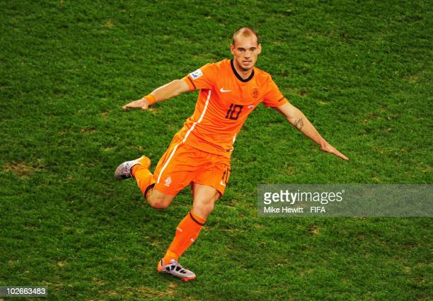 Wesley Sneijder of the Netherlands celebrates scoring the second goal during the 2010 FIFA World Cup South Africa Semi Final match between Uruguay...
