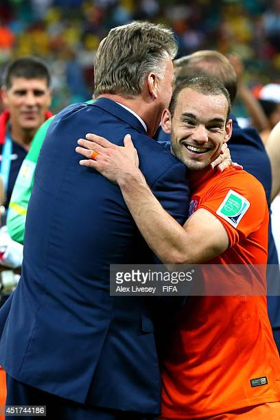 Wesley Sneijder of the Netherlands celebrates the win with head coach Louis van Gaal after the 2014 FIFA World Cup Brazil Quarter Final match between...