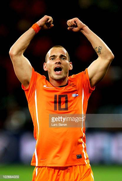 Wesley Sneijder of the Netherlands celebrates victory and progress to the final during the 2010 FIFA World Cup South Africa Semi Final match between...