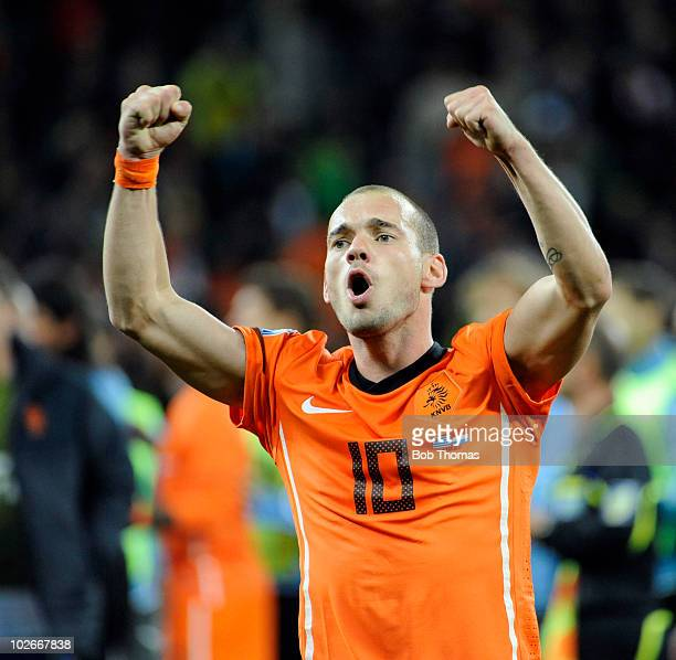 Wesley Sneijder of the Netherlands celebrates victory and progressing to the final after the 2010 FIFA World Cup South Africa Semi Final match...