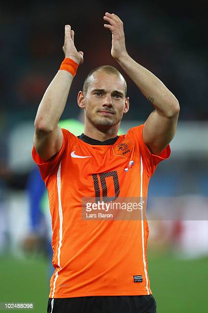 Wesley Sneijder of the Netherlands celebrates victory following the 2010 FIFA World Cup South Africa Round of Sixteen match between Netherlands and...