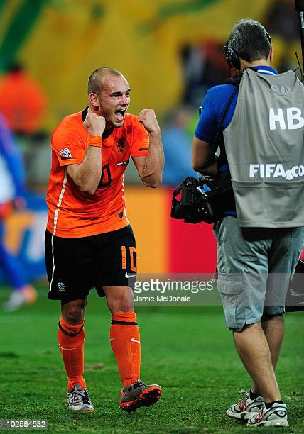 Wesley Sneijder of the Netherlands celebrates victory following the 2010 FIFA World Cup South Africa Quarter Final match between Netherlands and...