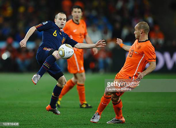 Wesley Sneijder of the Netherlands challenges Andres Iniesta of Spain during the 2010 FIFA World Cup South Africa Final match between Netherlands and...