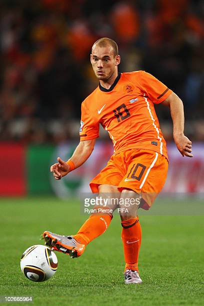 Wesley Sneijder of the Netherlands in action during the 2010 FIFA World Cup South Africa Semi Final match between Uruguay and the Netherlands at...