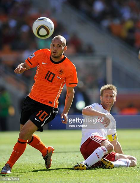 Wesley Sneijder of the Netherlands moves away from Martin Jorgensen of Denmark during the 2010 FIFA World Cup Group E match between Netherlands and...