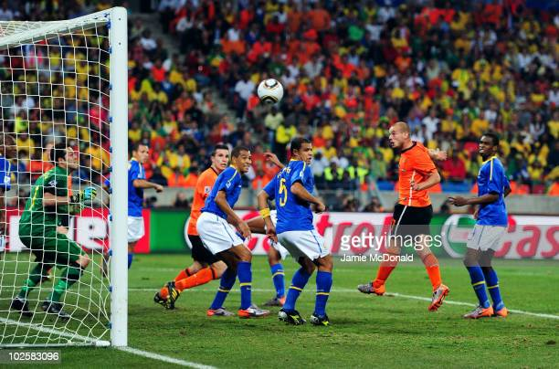 Wesley Sneijder of the Netherlands scores his team's second goal during the 2010 FIFA World Cup South Africa Quarter Final match between Netherlands...
