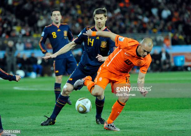 Wesley Sneijder of the Netherlands tackled by Xabi Alonso of Spain during the 2010 FIFA World Cup Final between the Netherlands and Spain on July 11...