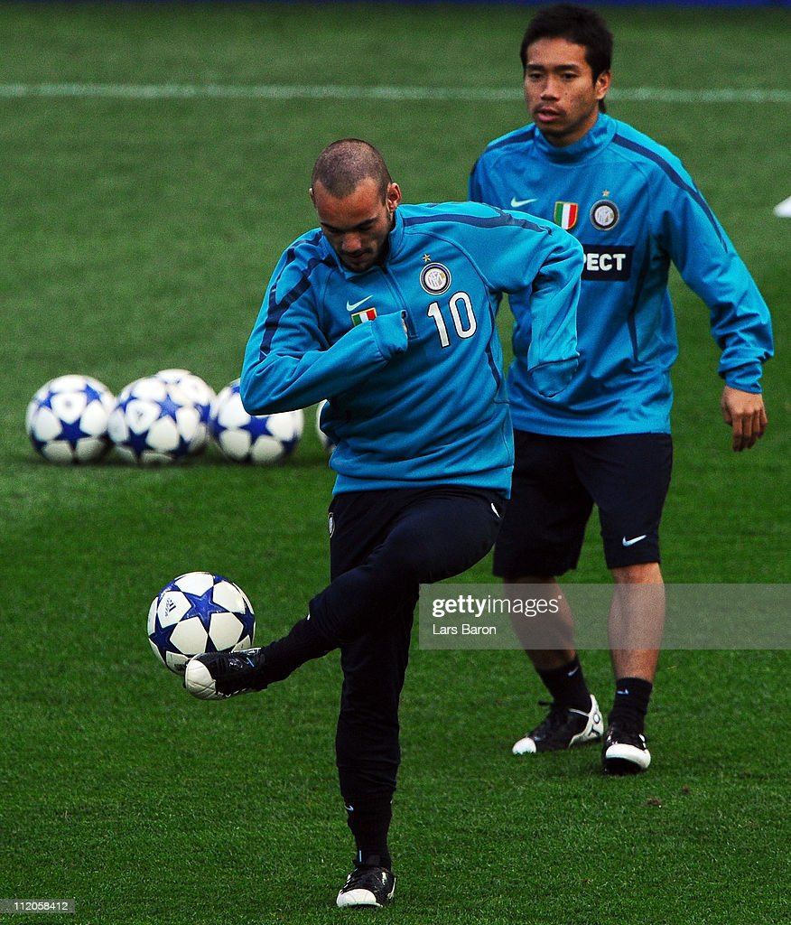 Wesley Sneijder plays with the ball next to team mate Yuto Nagatomo during a Inter Milan training session ahead of the UEFA Champions League quarter final second leg match against FC Schalke 04 at Veltins Arena on April 12, 2011 in Gelsenkirchen, Germany.