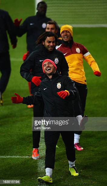 Wesley Sneijder smiles during a Galatasaray AS training session ahead of their UEFA Champions League round of 16 match against FC Schalke 04 at...