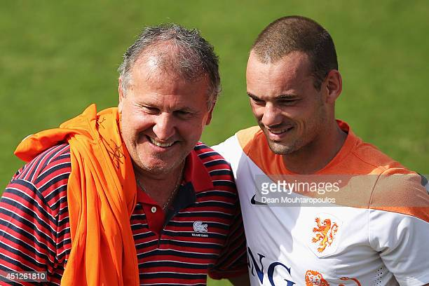Wesley Sneijder speaks and shares a joke with Brazilian football Legend Zico during the Netherlands training session at the 2014 FIFA World Cup...