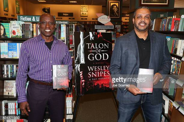 Wesley Snipes and Ray Norman attend a book signing for 'Talon Of God' at Barnes Noble on July 29 2017 in Huntington Beach California