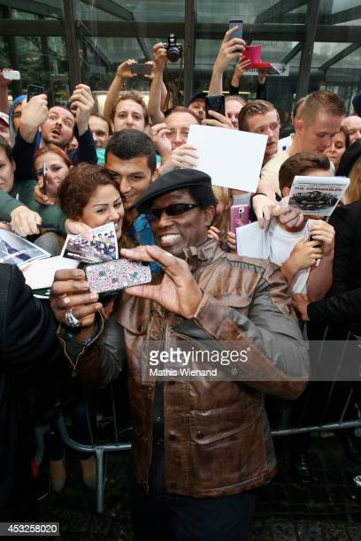 Wesley Snipes attends the premiere of the film 'The Expendables 3' at Residenz Kino on August 6 2014 in Cologne Germany