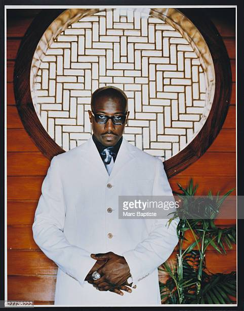 Wesley Snipes in White Suit under Circular Window