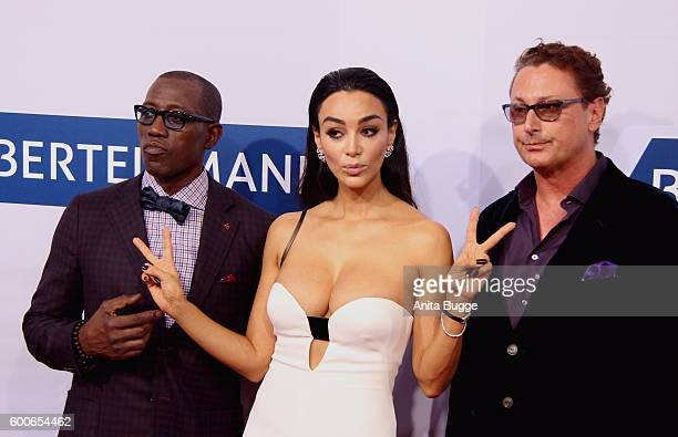 Wesley Snipes Verona Pooth and guest attend the Bertelsmann Summer Party at Bertelsmann Repraesentanz on September 8 2016 in Berlin Germany