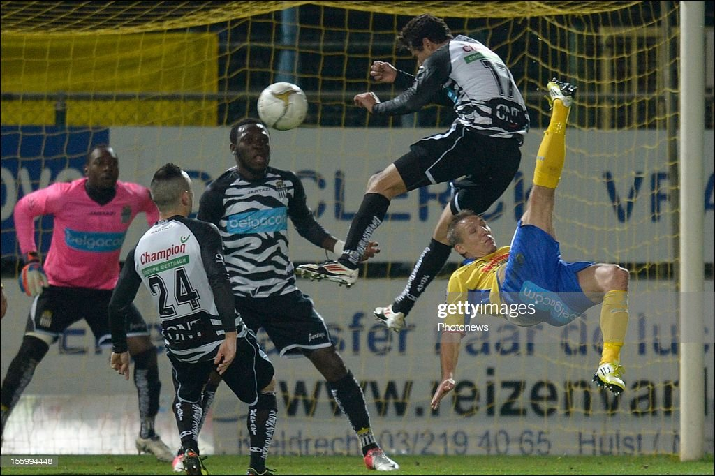 Wesley Sonck of Waasland Beveren battles for the ball with Matan Ohayon of Charleroi during the Jupiler League match between Waasland Beveren and RSC Charleroi on November 10, 2012 in Beveren, Belgium.