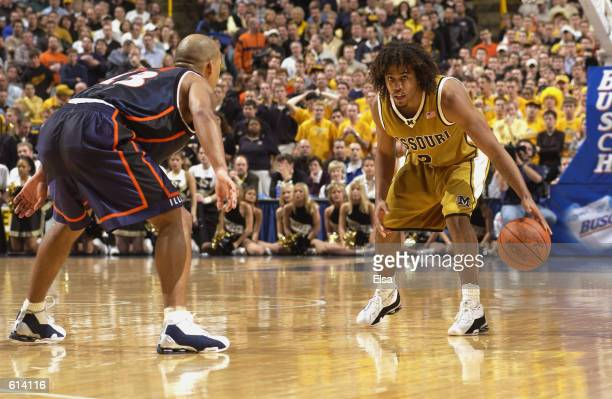 Wesley Stokes of the Missouri Tigers is defended by Cory Bradford of the Illinois Fighting Illini during the game at the the Savvis Center in St...