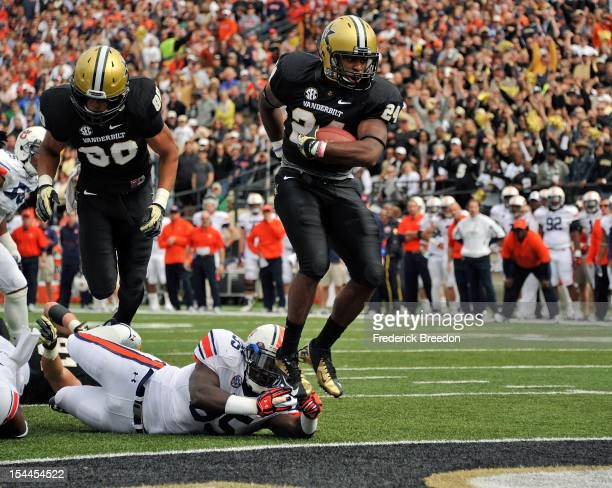 Wesley Tate of the Vanderbilt Commodores jumps over Jonathan Evans of the Auburn Tigers to score a touchdown at Vanderbilt Stadium on October 20 2012...