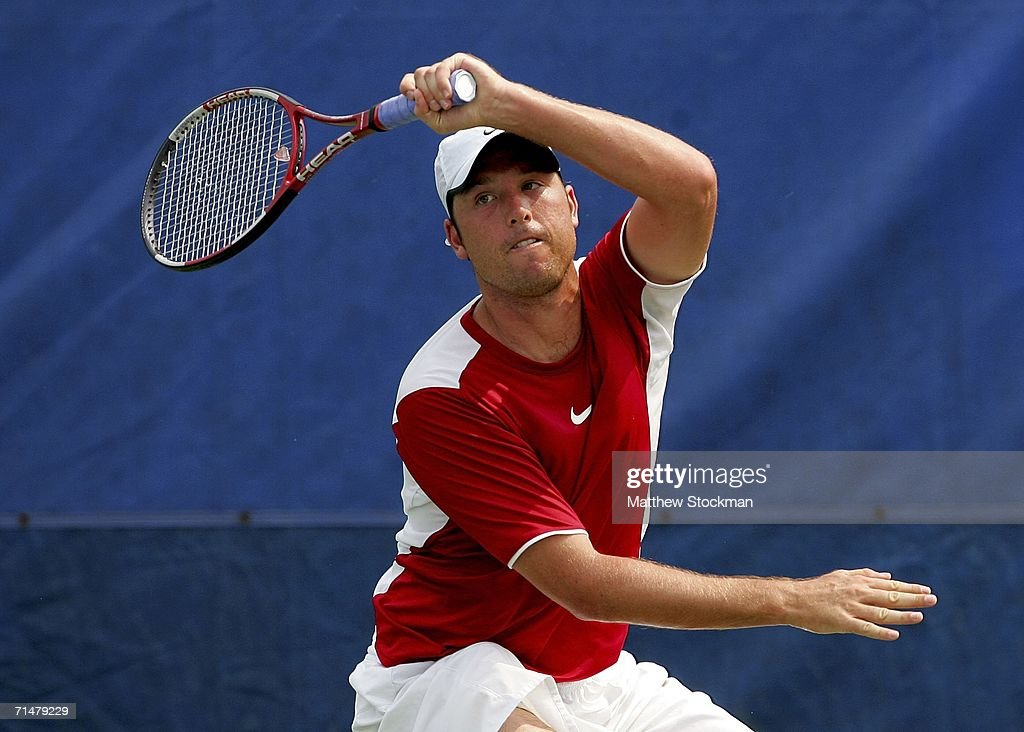 Wesley Whitehouse of South Africa returns a shot to Justin Gimelstob