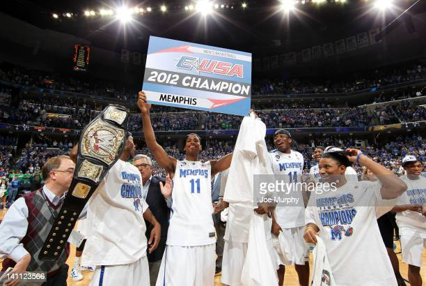 Wesley Witherspoon of the Memphis Tigers holds up the 2012 CUSA champion sign after a victory against the Marshall Thundering Herd during the...