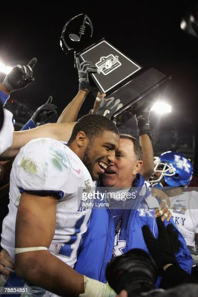 Wesley Woodson of the Kentucky Wildcats celebrates with head coach Rich Brooks after winning the Gaylord Hotels Music City Bowl against the Florida...
