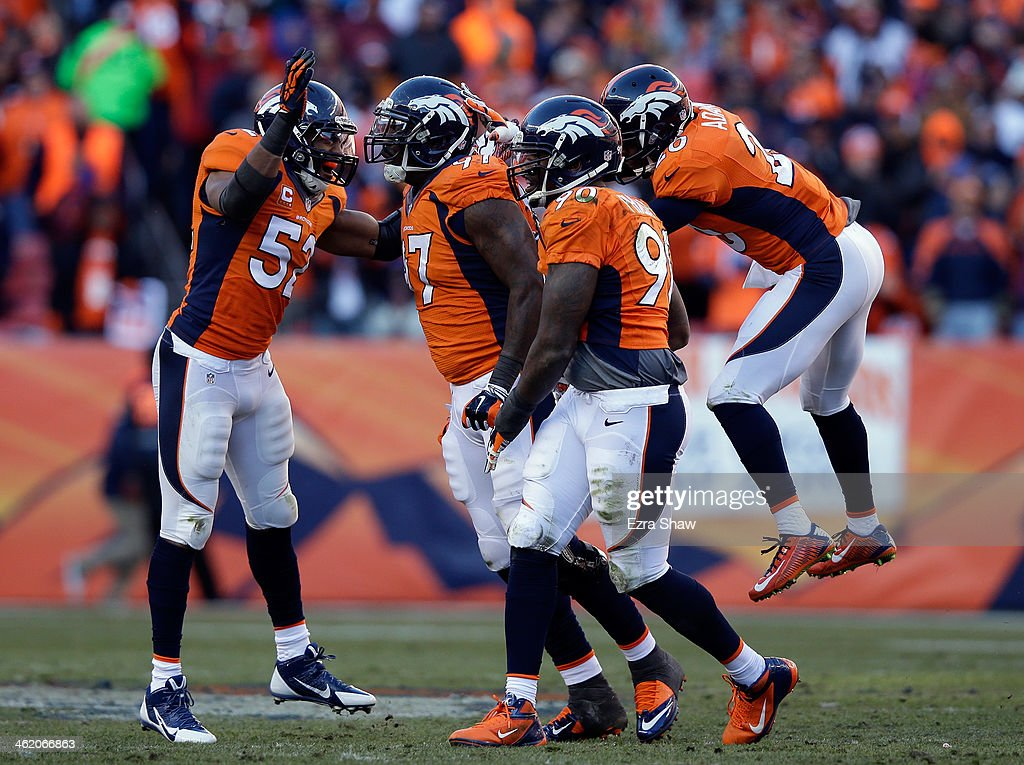 Wesley Woodyard #52, Malik Jackson #97, Shaun Phillips #90 and Mike Adams #20 of the Denver Broncos celebrate sacking Philip Rivers #17 of the San Diego Chargers during the AFC Divisional Playoff Game at Sports Authority Field at Mile High on January 12, 2014 in Denver, Colorado.