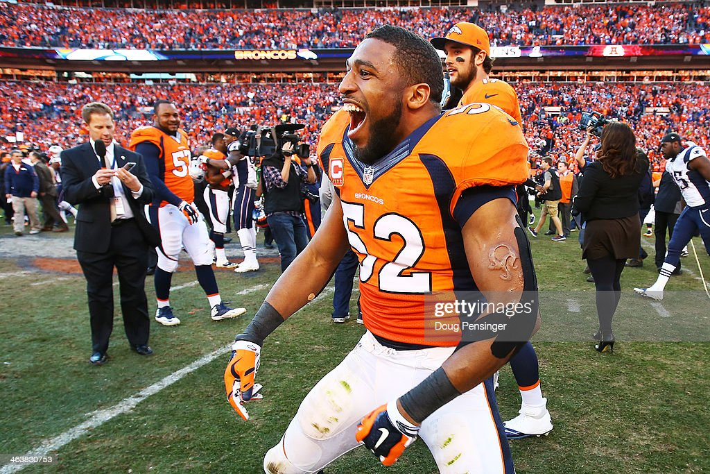 Wesley Woodyard #52 of the Denver Broncos celebrates their 26 to 16 win over the New England Patriots during the AFC Championship game at Sports Authority Field at Mile High on January 19, 2014 in Denver, Colorado.