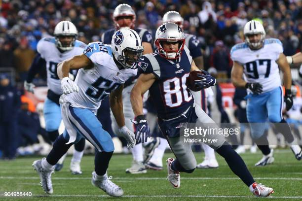 Wesley Woodyard of the Tennessee Titans tackles Danny Amendola of the New England Patriots during the AFC Divisional Playoff game at Gillette Stadium...