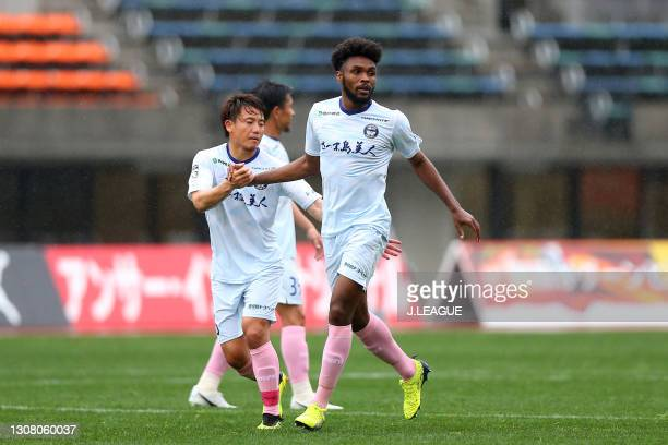 Weslley of Kagoshima United celebrates scoring his side's first goal with his team mate Keisuke Tanabe during the J.League Meiji Yasuda J3 match...