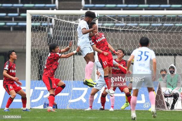 Weslley of Kagoshima United heads to score his side's first goal during the J.League Meiji Yasuda J3 match between Roasso Kumamoto and Kagoshima...