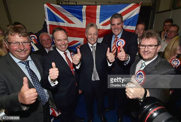 Wesminster leader Nigel Dodds celebrates with Peter Robinson and Gavin Robinson after his win as the General Election count takes place at the King's...