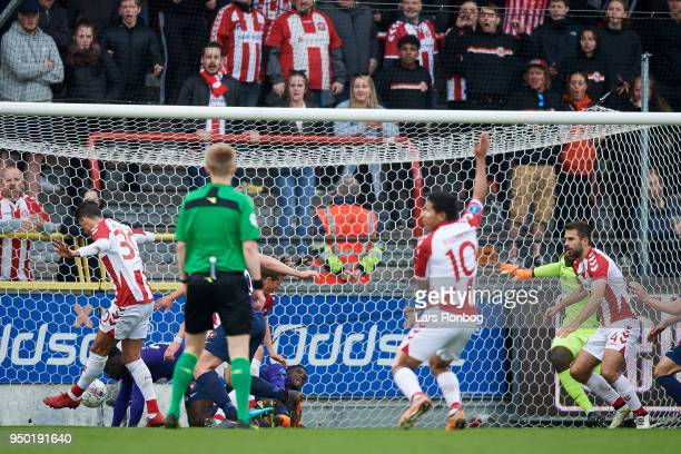 Wessam Abou Ali of AaB Aalborg scores the 32 goal again st Goalkeeper Bill Hamid of FC Midtjylland during the Danish Alka Superliga match between AaB...