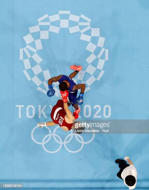 Wessam Salamana of Refugee Olympic Team exchanges punches with Wanderson de Oliveira of Brazil during the Men's Light on day two of the Tokyo 2020...
