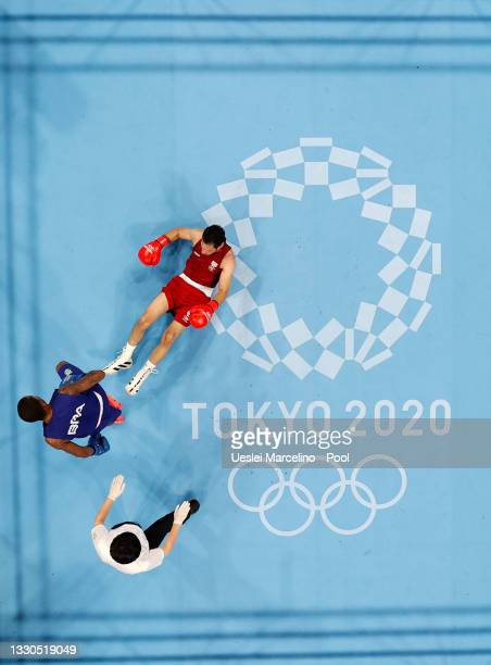 Wessam Salamana of Refugee Olympic Team is knocked down by Wanderson de Oliveira of Brazil during the Men's Light on day two of the Tokyo 2020...