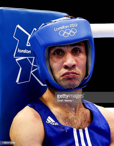 Wessam Slamana of Syria looks dejected during his Men's Bantam weight bout with Kanat Abutalipov of Kazakhstan on Day 1 of the London 2012 Olympic...