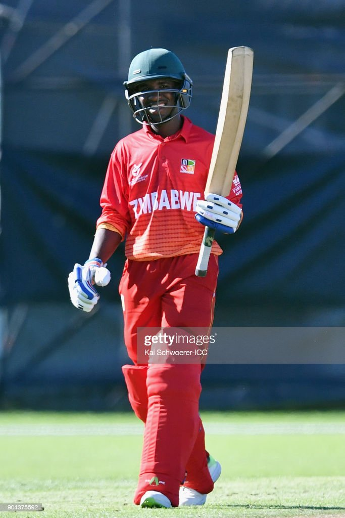 Wessely Madevere of Zimbabwe celebrates his half century during the ICC U19 Cricket World Cup match between Zimbabwe and Papua New Guinea at Lincoln Green on January 13, 2018 in Christchurch, New Zealand.
