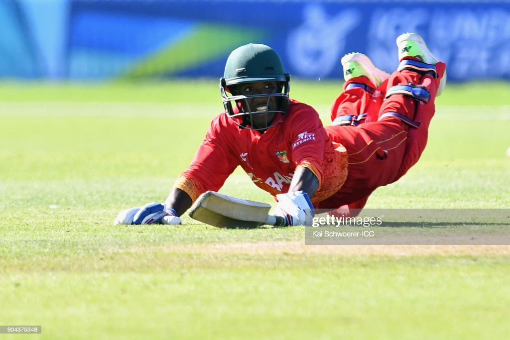 Wessely Madevere of Zimbabwe dives to save his wicket during the ICC U19 Cricket World Cup match between Zimbabwe and Papua New Guinea at Lincoln Green on January 13, 2018 in Christchurch, New Zealand.