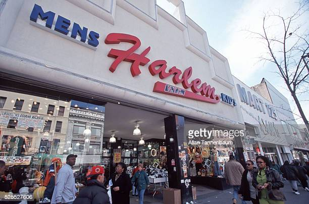 West 125th St in Harlem showing renaissance of shops and stores New York New York March 24 1998