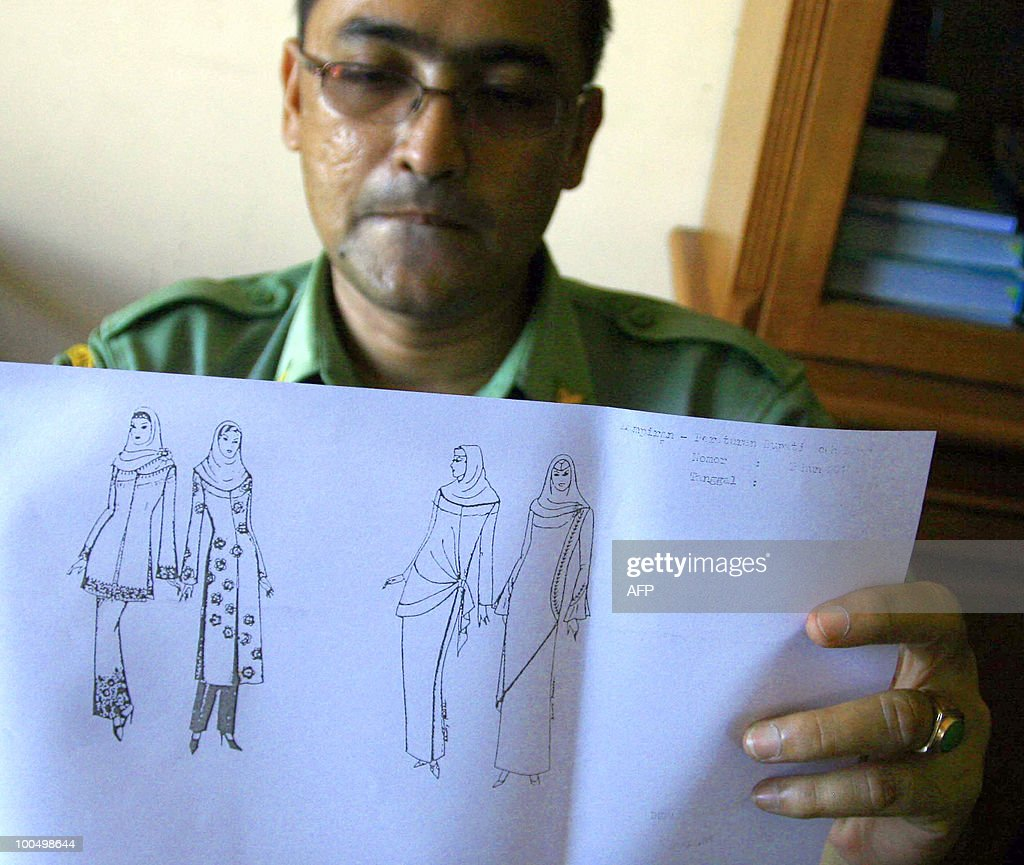 West Aceh district local government spokesman Mulia Agus, shows from his office in Meulaboh on May 24, 2010 a sketch illustrating what is acceptable female clothing in the locality. Authorities will soon implement a new regulation banning Muslim women from wearing 'tight' trousers or jeans. Any woman wearing trousers or jeans deemed to be too tight will have to immediately change into a government-issue skirt.