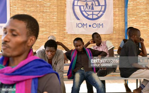 West African migrants and refugees having returned from Libya after fleeing armed groups and having failed to cross the Mediterranean to Europe wait...